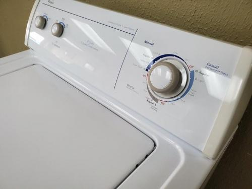Top load washer mechanical controls